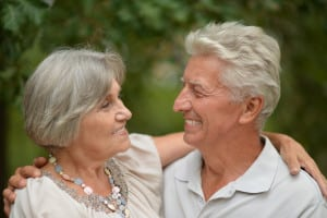 Senior couple smiling at one another